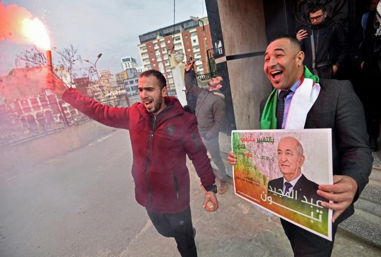 Supporters of Abdelmadjid Tebboune celebrate his victory in Algeria's presidential election
