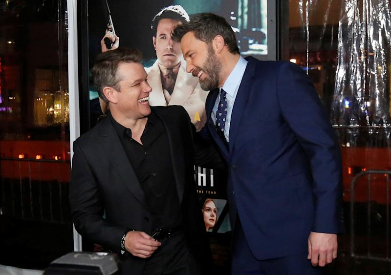 "Director and cast member Ben Affleck (R) greets actor Matt Damon at the premiere of ""Live by Night"" in Hollywood, California U.S., January 9, 2017. REUTERS/Mario Anzuoni"