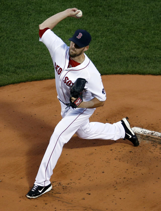Boston Red Sox starting pitcher John Lackey delivers to the Baltimore Orioles during the first inning of a baseball game at Fenway Park in Boston, Wednesday, Aug. 28, 2013. (AP Photo/Elise Amendola)
