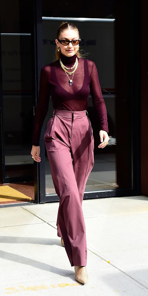"<p>The model proved to be a fan of the monochromatic trend while filming an episode <em>Beat Bobby Flay</em>. She wore a sheer turtleneck with matching trousers, along with a beige pair of <a href=""https://click.linksynergy.com/deeplink?id=93xLBvPhAeE&mid=42352&murl=https%3A%2F%2Fwww.shopbop.com%2Fisland-boot-kalda%2Fvp%2Fv%3D1%2F1582698301.htm&u1=IS%2CLOTD102819-Hadid-Embed%2Ckchiello1271%2C%2CIMA%2C3492506%2C201910%2CI"" target=""_blank"">Kalda Island boots</a> ($480), a few layered necklaces, and Lili Claspe hoops.</p>"