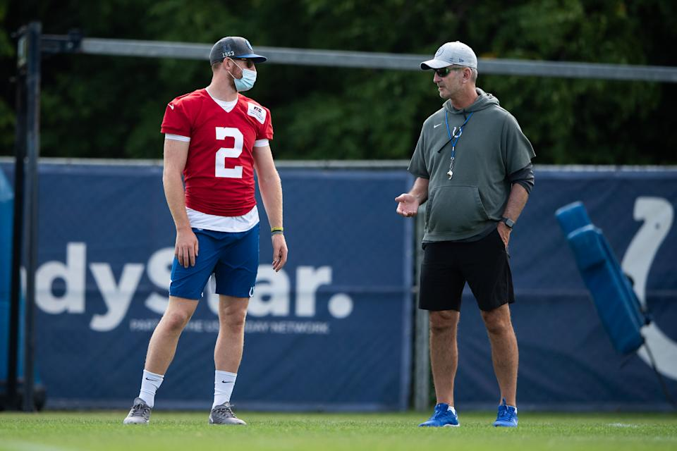 WESTFIELD, IN - AUGUST 07: Indianapolis Colts quarterback Carson Wentz (2) talks to Indianapolis Colts head coach Frank Reich during the Indianapolis Colts training camp practice on August 7, 2021 at Grand Park Sports Complex in Westfield, IN. (Photo by Zach Bolinger/Icon Sportswire via Getty Images)