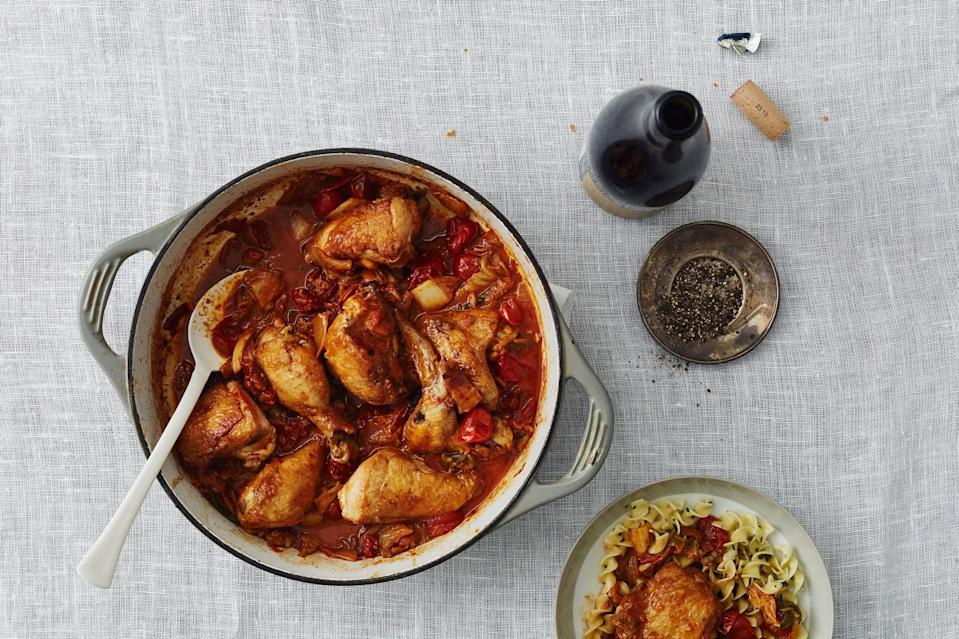 """A combo of salty bacon and spicy, tangy kimchi makes this slow-cooked, tomatoey braise sing with deep, resounding flavor. <a href=""""https://www.epicurious.com/recipes/food/views/kimchi-braised-chicken-with-bacon?mbid=synd_yahoo_rss"""" rel=""""nofollow noopener"""" target=""""_blank"""" data-ylk=""""slk:See recipe."""" class=""""link rapid-noclick-resp"""">See recipe.</a>"""