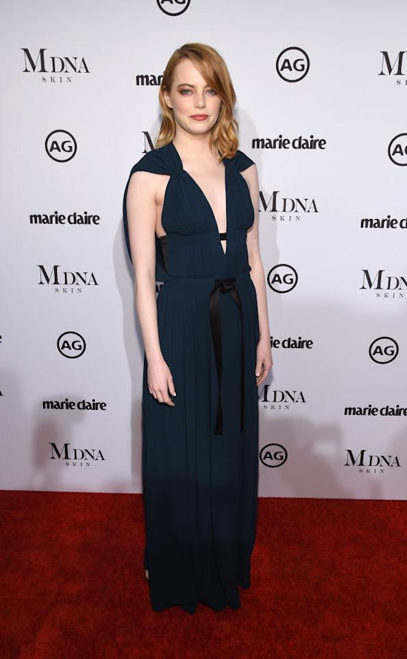 <p>Emma Stone chose an emerald gown by go-to label Louis Vuitton for the Marie Claire Image Makers Awards on Thursday 11 January. <em>[Photo: Getty]</em> </p>
