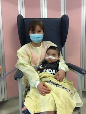 Chi-hoi pictured with his mother. Photo: Handout