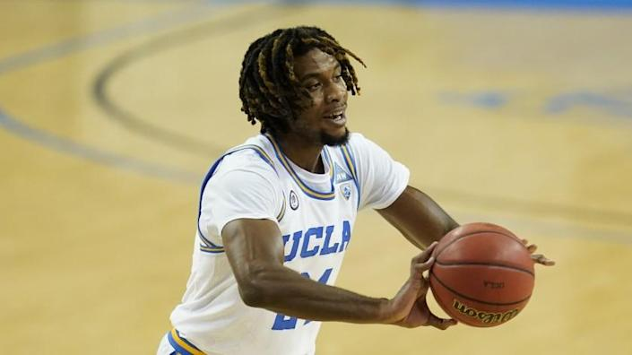 UCLA forward Jalen Hill (24) passes the ball during an NCAA college basketball game.