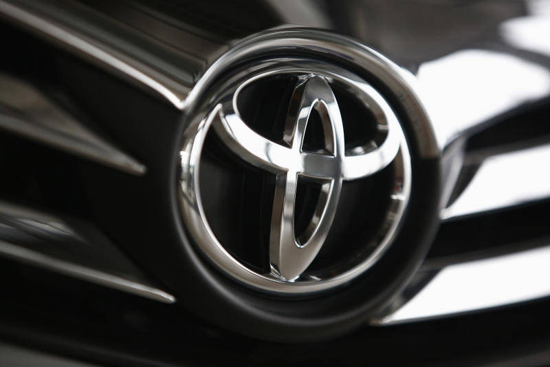 File Photo: A Toyota logo is seen on a car inside a showroom at a Toyota dealership in Warsaw April 11, 2014. Toyota Motor Corp announced that it would call back 3.4 million vehicles globally. REUTERS/Kacper Pempel
