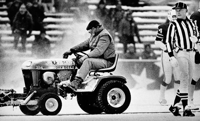 Plow driver Mark Henderson went down in sports infamy after clearing the snow for Patriots kicker John Smith before a field-goal attempt against the Dolphins. (AP)