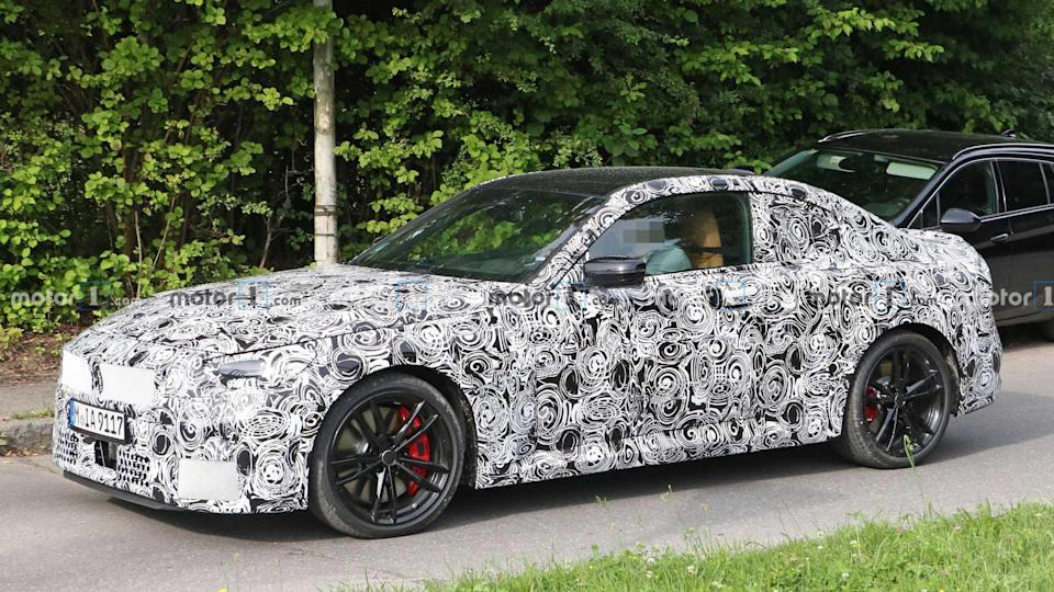 """<p>BMW isn't stripping much camo off the new <a href=""""https://www.motor1.com/bmw/2-series/"""" rel=""""nofollow noopener"""" target=""""_blank"""" data-ylk=""""slk:2 Series Coupe"""" class=""""link rapid-noclick-resp"""">2 Series Coupe</a> yet. It has an attractive silhouette, though.</p> <h3><a href=""""https://www.motor1.com/news/437682/2022-bmw-2-series-spy/"""" rel=""""nofollow noopener"""" target=""""_blank"""" data-ylk=""""slk:2022 BMW 2 Series Coupe Caught Inside And Out In Nearly 50 Spy Shots"""" class=""""link rapid-noclick-resp"""">2022 BMW 2 Series Coupe Caught Inside And Out In Nearly 50 Spy Shots</a></h3>  <h2>Motor1.com's Drives This Week:</h2><ul><li><a href=""""https://www.motor1.com/reviews/437563/2020-volkswagen-passat-review/?utm_campaign=yahoo-feed"""" rel=""""nofollow noopener"""" target=""""_blank"""" data-ylk=""""slk:2020 Volkswagen Passat SEL Review: Left In The Dust"""" class=""""link rapid-noclick-resp"""">2020 Volkswagen Passat SEL Review: Left In The Dust</a></li><br><li><a href=""""https://www.motor1.com/reviews/436881/2020-ford-transit-xlt-passenger-review/?utm_campaign=yahoo-feed"""" rel=""""nofollow noopener"""" target=""""_blank"""" data-ylk=""""slk:2020 Ford Transit XLT Passenger Review: Personal Personnel Carrier"""" class=""""link rapid-noclick-resp"""">2020 Ford Transit XLT Passenger Review: Personal Personnel Carrier</a></li><br></ul>"""