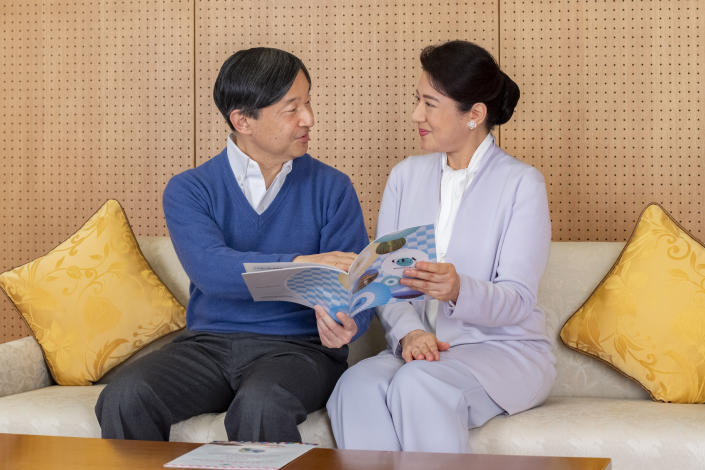 In this photo provided on Feb. 18, 2021, by the Imperial Household Agency of Japan, Japan's Emperor Naruhito, left, and Empress Masako talk at Akasaka Palace in Tokyo on Feb. 2, 2021. Naruhito celebrated 61st birthday on Tuesday, Feb. 23, 2021. (The Imperial Household Agency of Japan via AP)