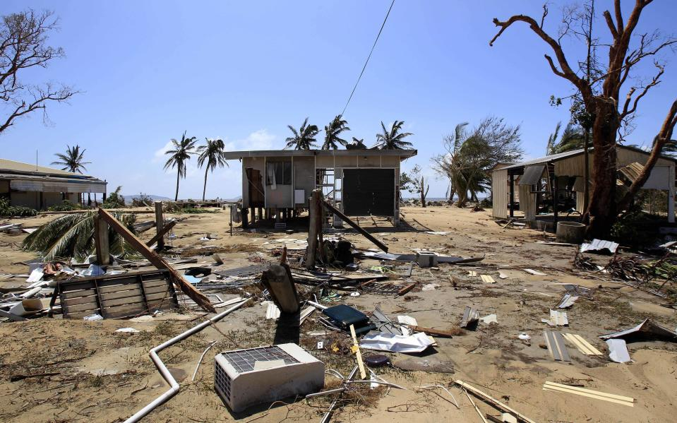 A beachside house is destroyed in Tully Heads by Cyclone Yasi. Source: AAP