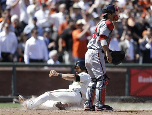 San Francisco Giants' Angel Pagan, left, slides to score past Washington Nationals catcher Kurt Suzuki in the eighth inning of a baseball game on Wednesday, May 22, 2013, in San Francisco. Pagan scored on a single by Giants' Buster Posey. (AP Photo/Ben Margot)