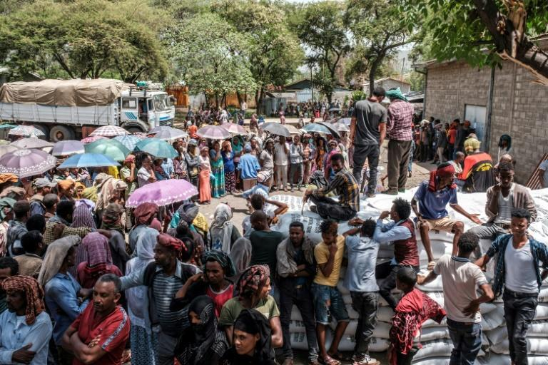 Most residents have fled the town, with crowds gathering only when officials hand out sacks of wheat as food aid.