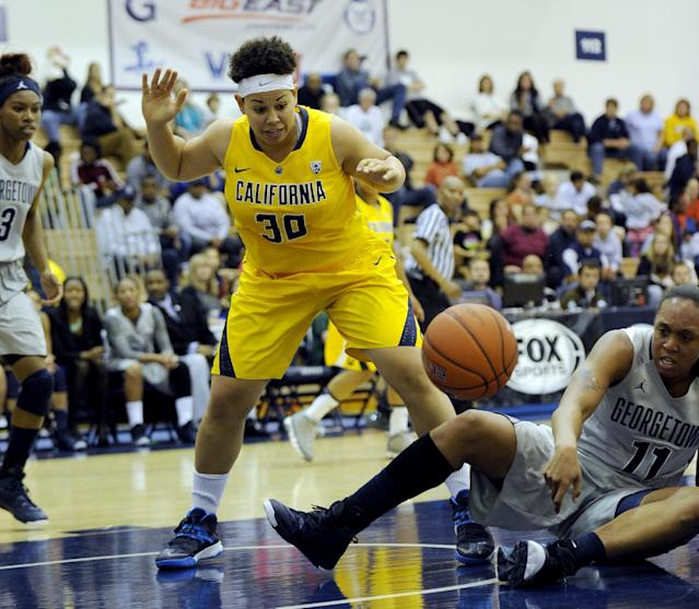 California guard Mikayla Lyles (30) battles for the loose ball against Georgetown forward Andrea White (11) during the first half of an NCAA women's college basketball game, Sunday, Nov. 17, 2013, in Washington. (AP Photo/Nick Wass)