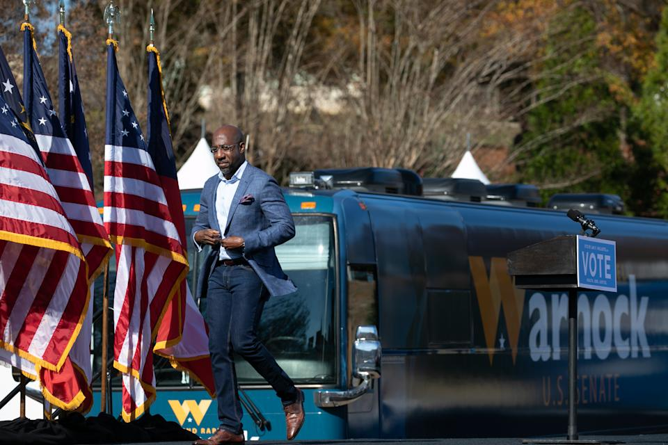 Georgia Democratic Senate candidate Rev. Raphael Warnock leaves the stage after addressing the crowd during a drive-in rally in Columbus, Georgia. (Photo by Jessica McGowan/Getty Images)
