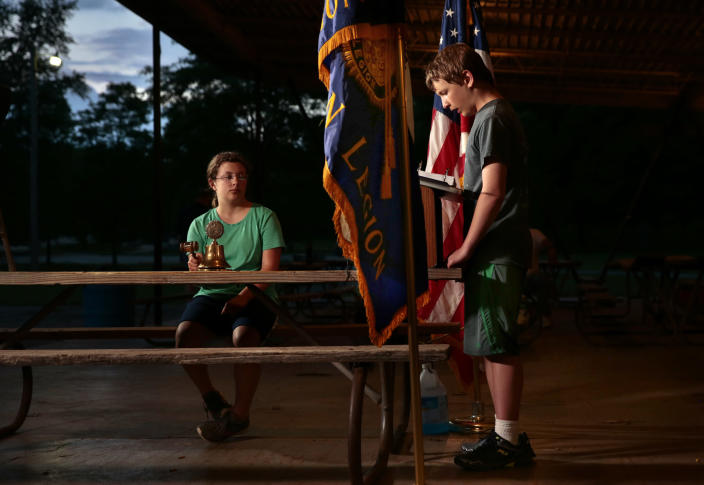 <p>Brody Nations, 13, of St. Louis, reads some of the 36,574 people who died in the Korean War as his sister Carleigh Nations, 11, rings a bell for each name read at Sylvan Springs County Park on Friday, May 25, 2018. (Photo: Robert Cohen/St. Louis Post-Dispatch via AP) </p>