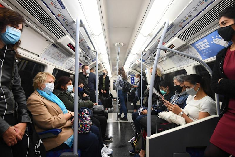 Passengers ride in an Underground train during the rush hour in London on Wednesday: PA