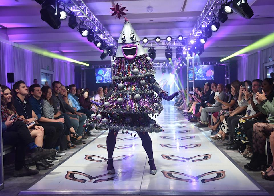 The Tree from The Masked poses at the end of the runway
