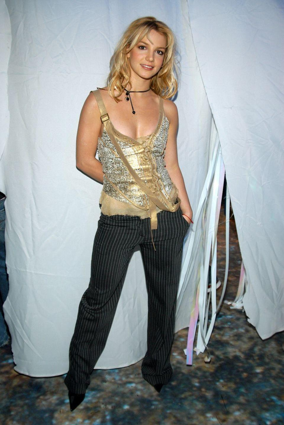 <p>Britney Spears visits MTV's TRL Treadmill-A-Thon on October 22, 2003.</p>