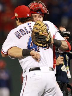 Game 4 heroes Mike Napoli and Derek Holland embrace after the Rangers beat the Cardinals 4-0 to even the World Series at two games apiece