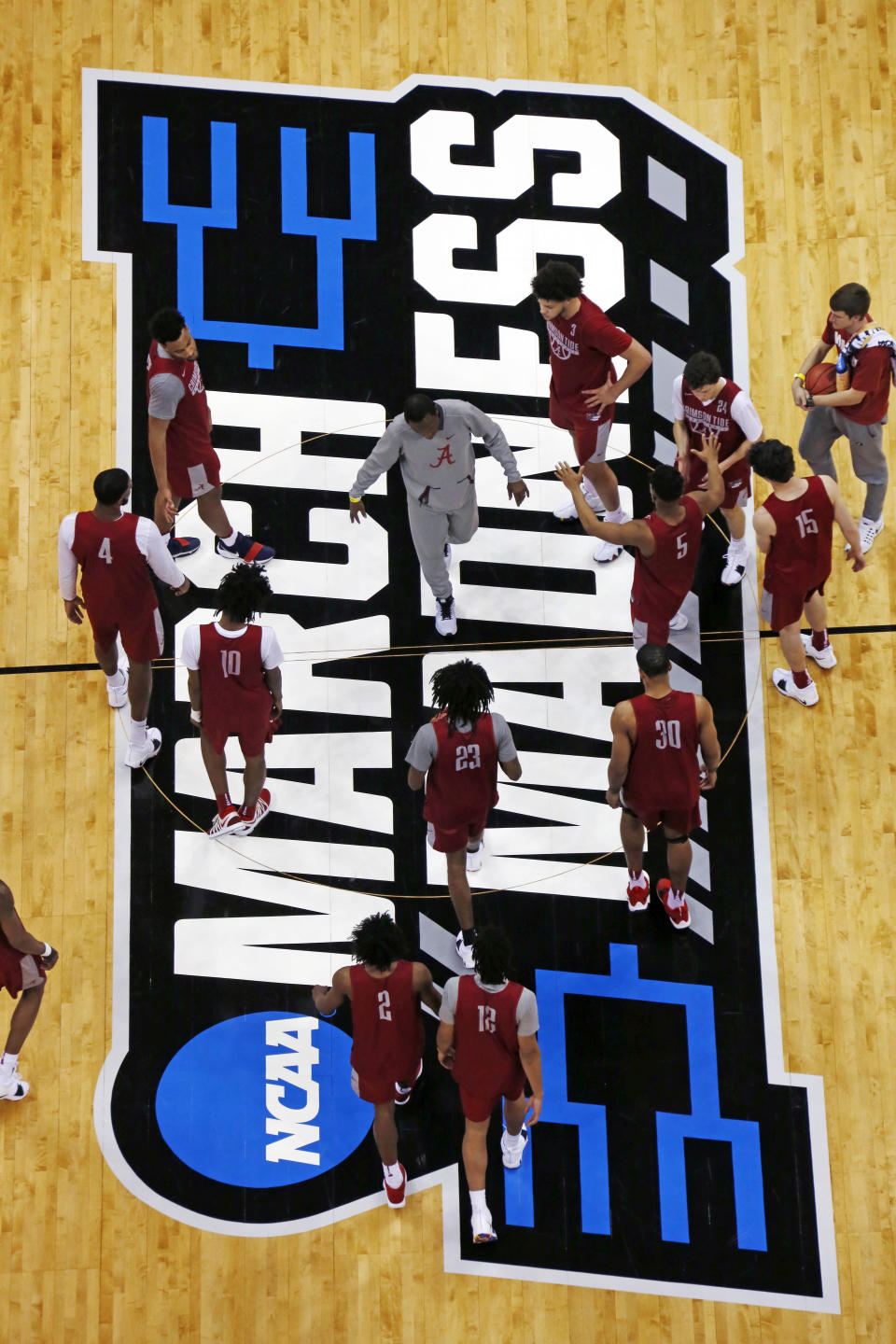 Alabama coach Avery Johnson, center, gathers his team at center court during a practice in preparation for a NCAA men's college basketball tournament first-round game, in Pittsburgh Wednesday, March 14, 2018. Alabama plays Virginia Tech on Thursday. AP Photo/Gene J. Puskar)