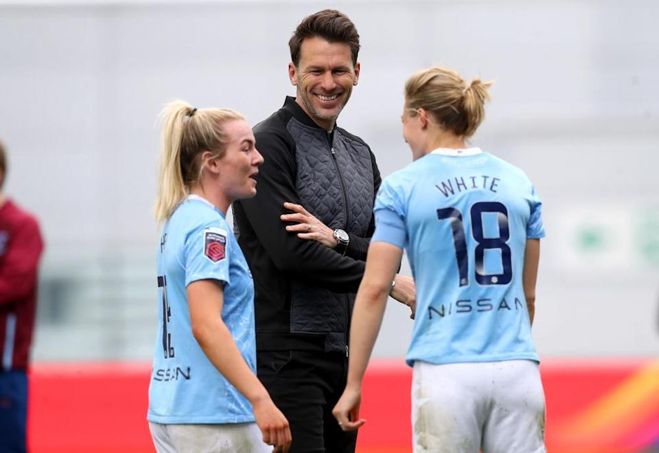 Gareth Taylor in conversation with Lauren Hemp (left) and Ellen White at the end of an FA Cup game in May.