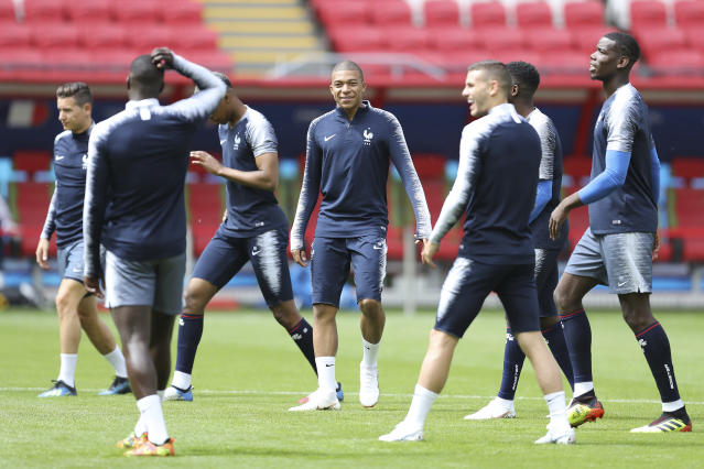 France's Kylian Mbappe smiles with teammates during France's official training on the eve of the group C match between France and Australia at the 2018 soccer World Cup in the Kazan Arena in Kazan, Russia, Friday, June 15, 2018. (AP Photo/David Vincent)