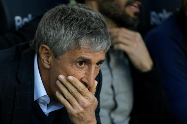Quique Setien defended his relationship with Barcelona's players ahead of Tuesday's game at home to Atletico Madrid. (AFP Photo/LLUIS GENE)