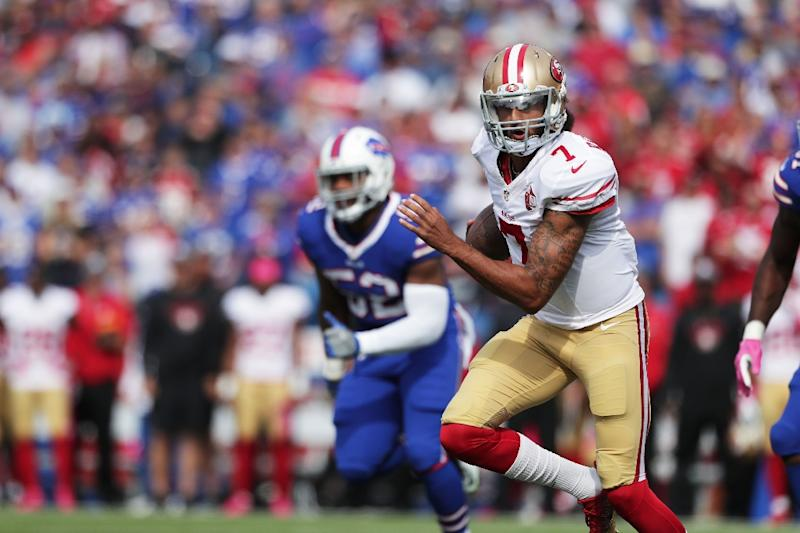 Colin Kaepernick of the San Francisco 49ers runs the ball against the Buffalo Bills on October 16, 2016 (AFP Photo/Brett Carlsen)
