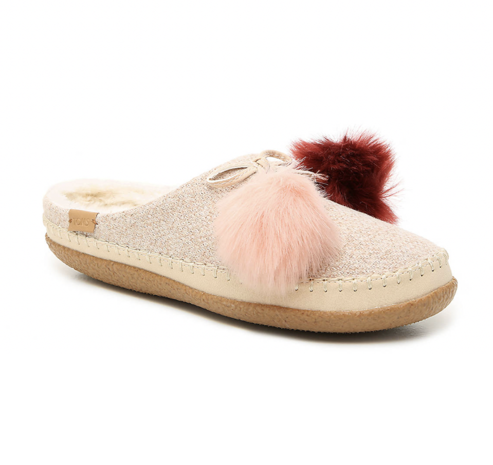 """<p><strong>Toms</strong></p><p>dsw.com</p><p><strong>$68.99</strong></p><p><a href=""""https://go.redirectingat.com?id=74968X1596630&url=https%3A%2F%2Fwww.dsw.com%2Fen%2Fus%2Fproduct%2Ftoms-ivy-pom-scuff-slipper%2F453830&sref=https%3A%2F%2Fwww.seventeen.com%2Ffashion%2Fg32434960%2Fcute-slippers%2F"""" rel=""""nofollow noopener"""" target=""""_blank"""" data-ylk=""""slk:Shop Now"""" class=""""link rapid-noclick-resp"""">Shop Now</a></p><p>Add pom-poms to anything and I'll buy it – including these adorable slip-ons. </p>"""