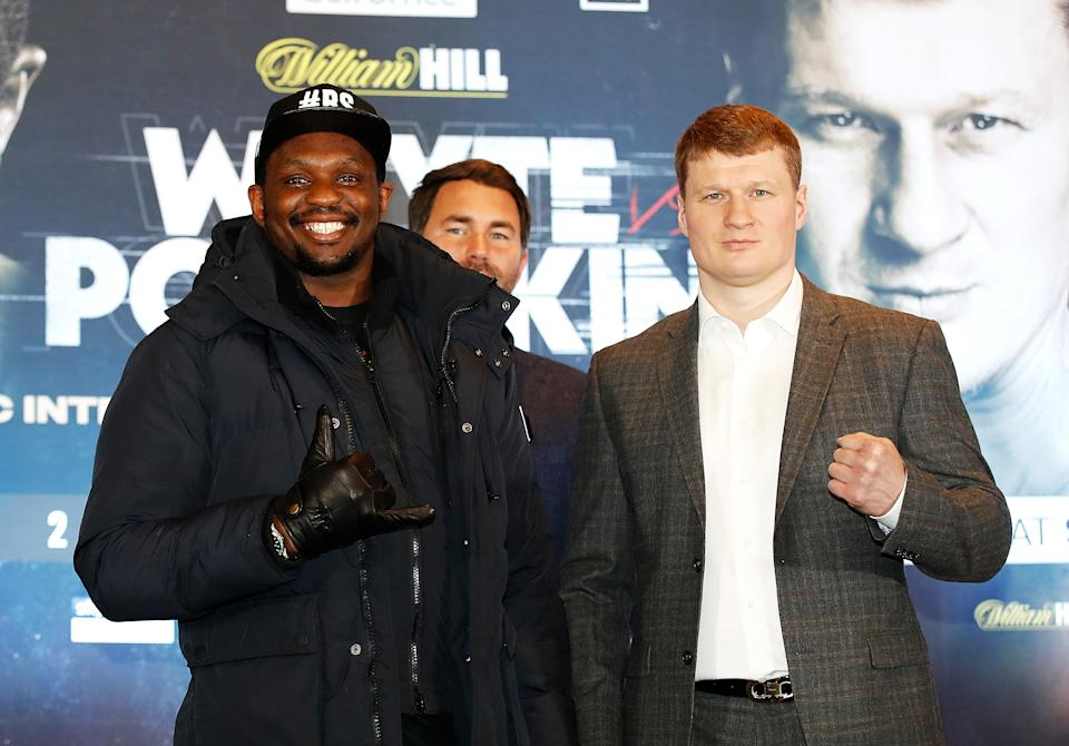 Dillian Whyte (left) and Alexander Povetkin during the press conference at Mercure Manchester Piccadilly Hotel. (Photo by Martin Rickett/PA Images via Getty Images)