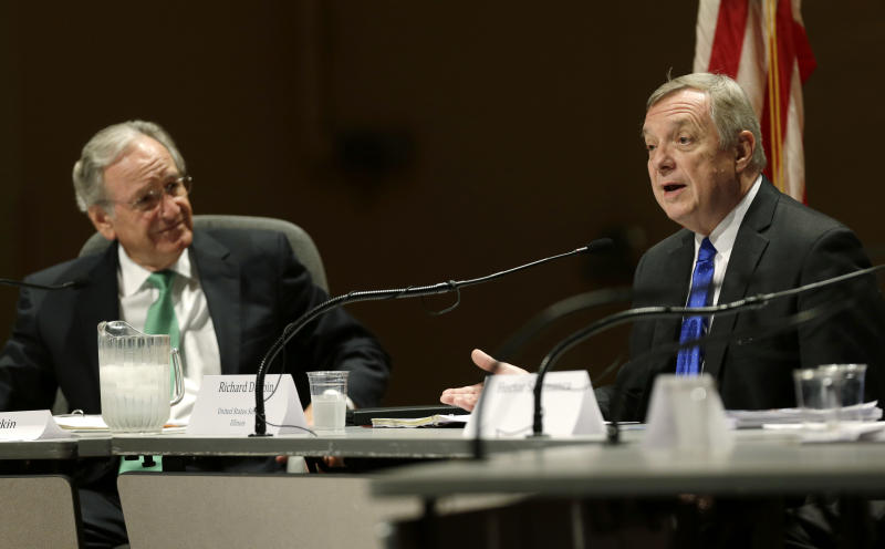 U.S. Sen. Dick Durbin (D-Ill.), right, speaks during a forum on immigration as U.S. Sen. Tom Harkin (D-Iowa) looks on, Friday, Aug. 2, 2013, in Ames, Iowa. (AP Photo/Charlie Neibergall)