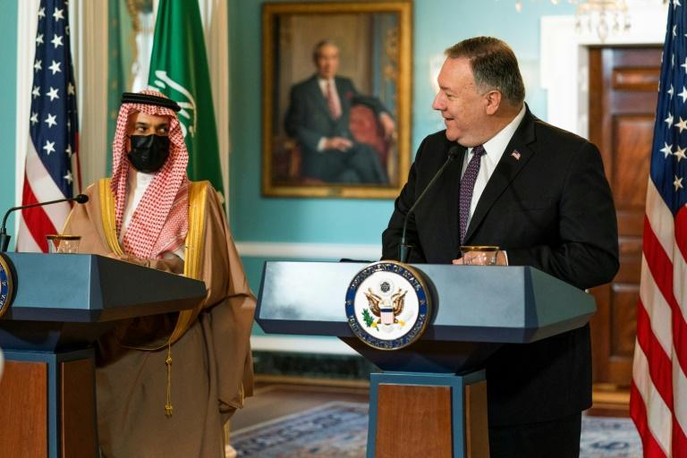 Secretary of State Mike Pompeo glances to Saudi Foreign Minister Prince Faisal bin Farhan Al Saud at the State Department in October 2020