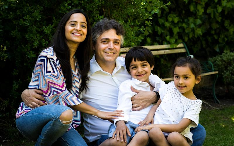 Recovered: Dr Alessandro Giardini, pictured at at home with his wife, Priyanka, and their children - NHSBT/Fleeting Moments Photography