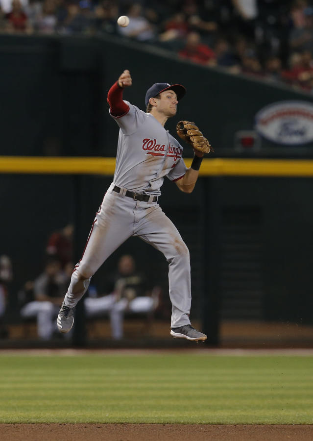 Washington Nationals shortstop Trea Turner makes a off-balance throw for an out on a ball hit by Arizona Diamondbacks' Nick Ahmed in the fourth inning during a baseball game, Sunday, Aug. 4, 2019, in Phoenix. (AP Photo/Rick Scuteri)