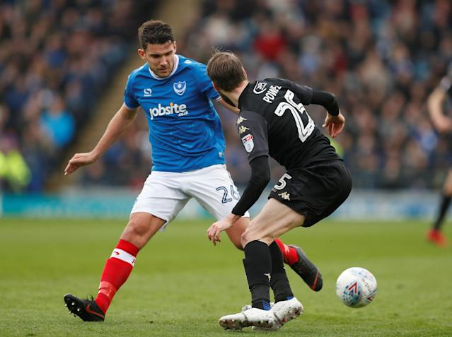 """Soccer Football - League One - Portsmouth vs Wigan Athletic - Fratton Park, Portsmouth, Britain - April 2, 2018 Portsmouth's Gareth Evans in action with Wigan's Nick Powell Action Images/Matthew Childs EDITORIAL USE ONLY. No use with unauthorized audio, video, data, fixture lists, club/league logos or """"live"""" services. Online in-match use limited to 75 images, no video emulation. No use in betting, games or single club/league/player publications. Please contact your account representative for further details."""