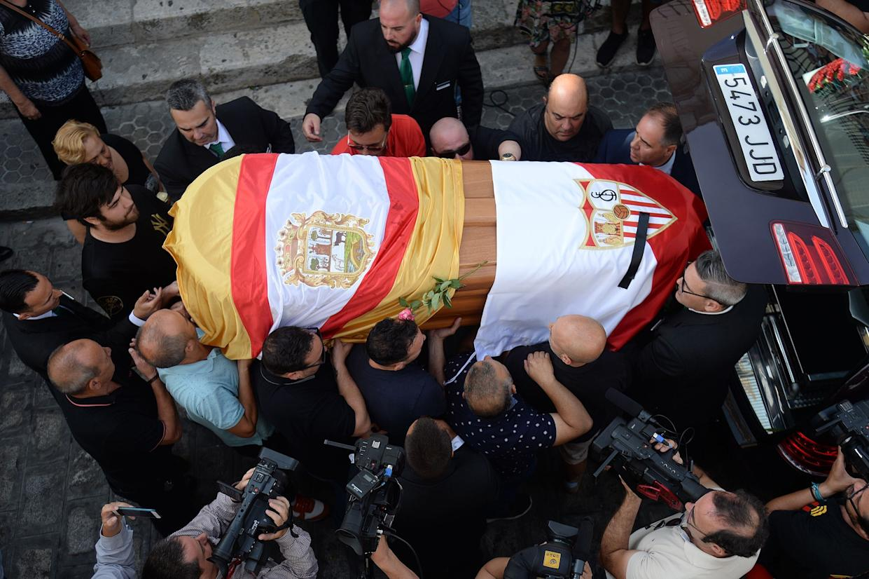 The coffin with the remains of Spanish football player Jose Antonio Reyes, covered with the flags of the village of Utrera and Sevilla FC football team, is carried on shoulders to the Santa Maria de Mesa church in Utrera, during the funeral for the footballer on June 3, 2019. - Former Arsenal, Real Madrid and Spain forward, Jose Antonio Reyes, 35, was killed in a car crash on June 1, 2019. Reyes shot to fame at Sevilla and secured a switch to Arsenal, where he was part of the unbeaten 'Invincibles' 2003-2004 Premier League winners, before spells at Real and Atletico Madrid. (Photo by CRISTINA QUICLER / AFP)        (Photo credit should read CRISTINA QUICLER/AFP/Getty Images)