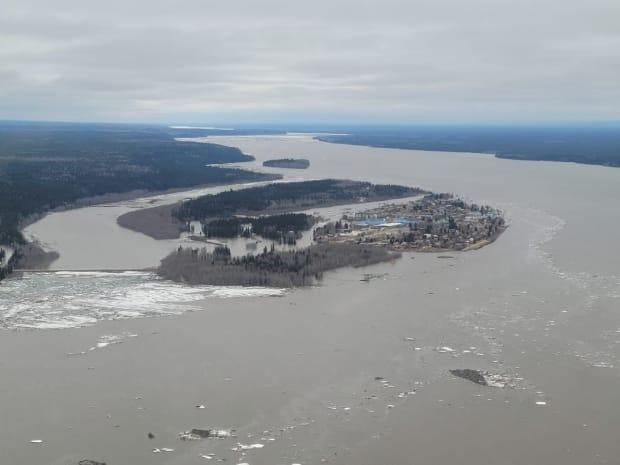 Rising water levels limited access to the island on which the community of Fort Simpson is built, as seen in this aerial image taken May 14 around noon. (Laurie Ozmun Nadia/Facebook - image credit)