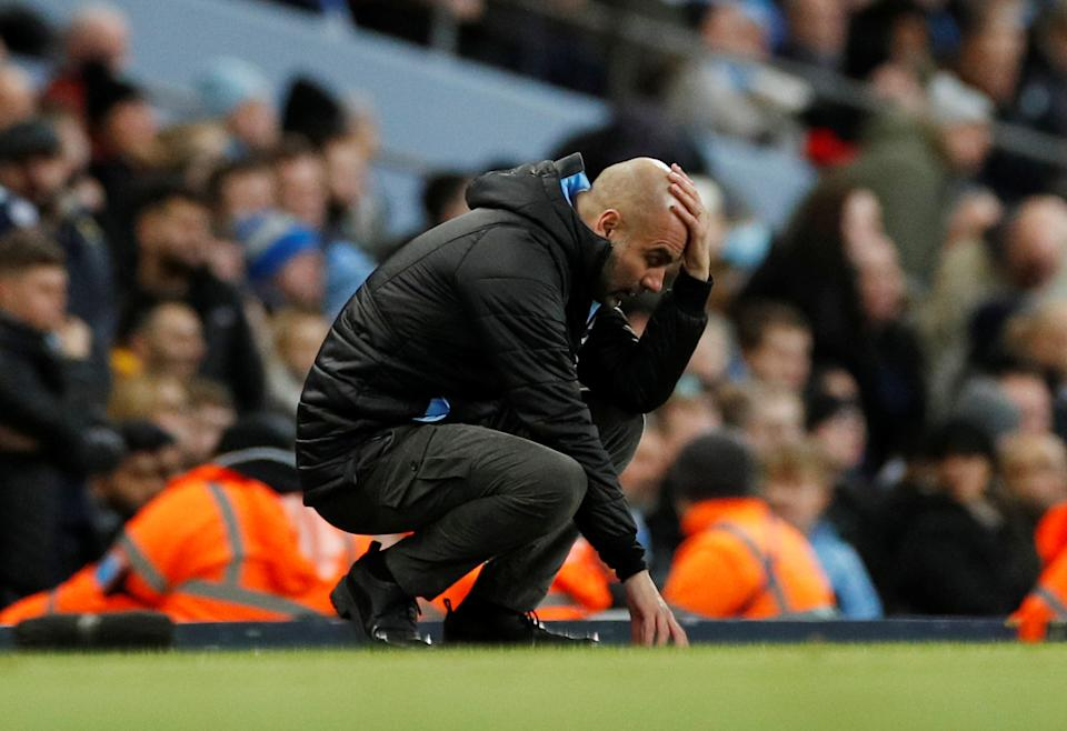 """Soccer Football - Carabao Cup - Semi Final Second Leg - Manchester City v Manchester United - Etihad Stadium, Manchester, Britain - January 29, 2020   Manchester City manager Pep Guardiola reacts   REUTERS/Phil Noble    EDITORIAL USE ONLY. No use with unauthorized audio, video, data, fixture lists, club/league logos or """"live"""" services. Online in-match use limited to 75 images, no video emulation. No use in betting, games or single club/league/player publications.  Please contact your account representative for further details."""