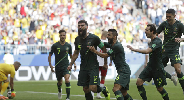 Australia's Mile Jedinak, third left, celebrates scoring his side's opening goal during the group C match between Denmark and Australia at the 2018 soccer World Cup in the Samara Arena in Samara, Russia, Thursday, June 21, 2018. (AP Photo/Gregorio Borgia)
