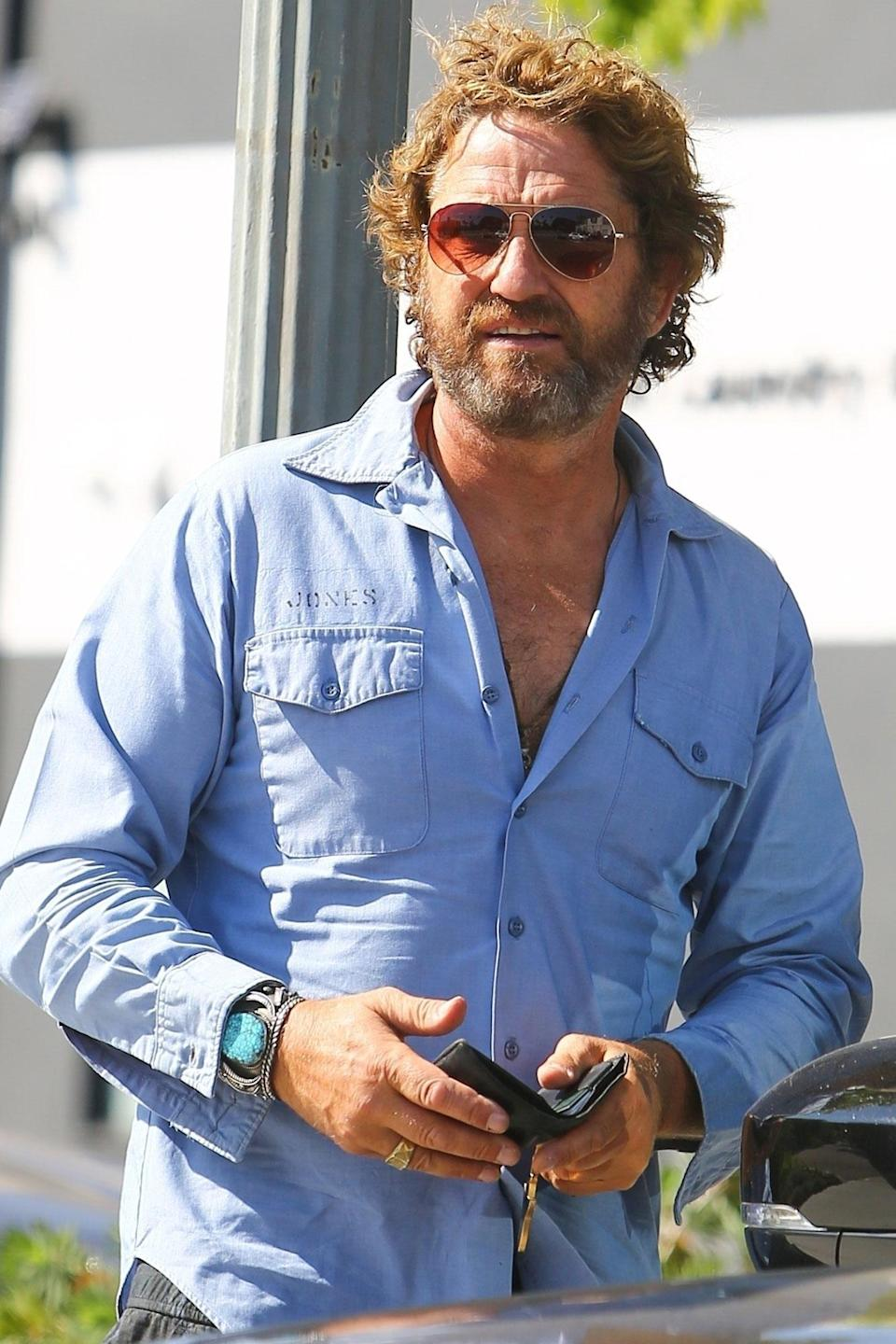 <p>Gerard Butler looks cool in aviator sunglasses during a meeting with his friend in Pacific Palisades, California, on Saturday.</p>