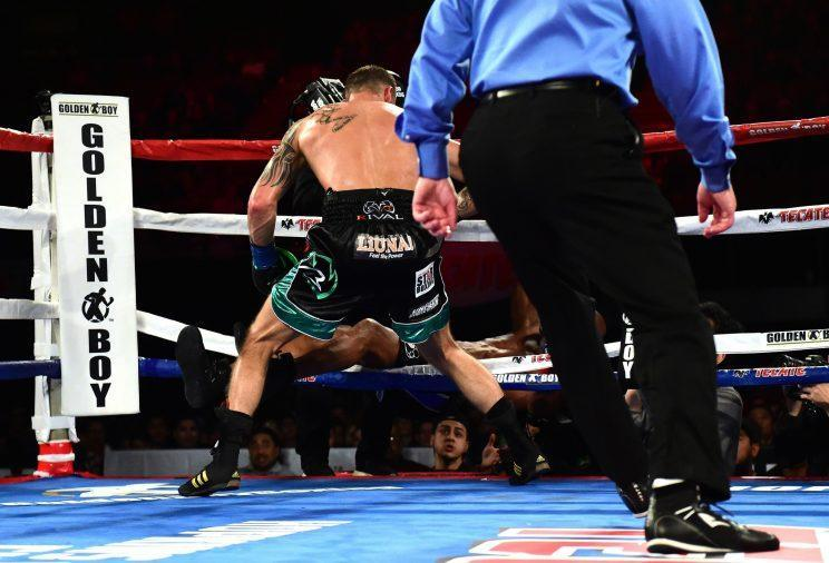 Joe Smith (back to camera) knocks Bernard Hopkins through the ropes, ending the 51-year-old legend's career Saturday in the eighth round of their bout at The Forum in Inglewood, Calif. (Getty Images)