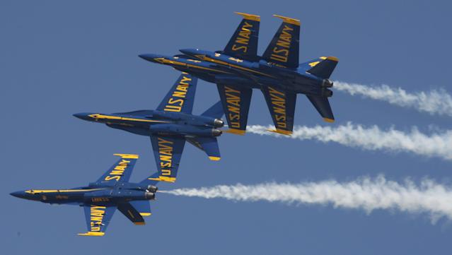 Members of the U.S. Navy Blue Angels perform during the Andrews Air Show at Joint Base Andrews, Maryland, in this May 19, 2012, file photo. The renowned Blue Angels precision flying team will return to the skies next year for a full air show season after being grounded for much of 2013 because of federal spending cuts, the U.S. Navy said, October 22, 2013. REUTERS/Stelios Varias/Files (UNITED STATES - Tags: TRANSPORT MILITARY)
