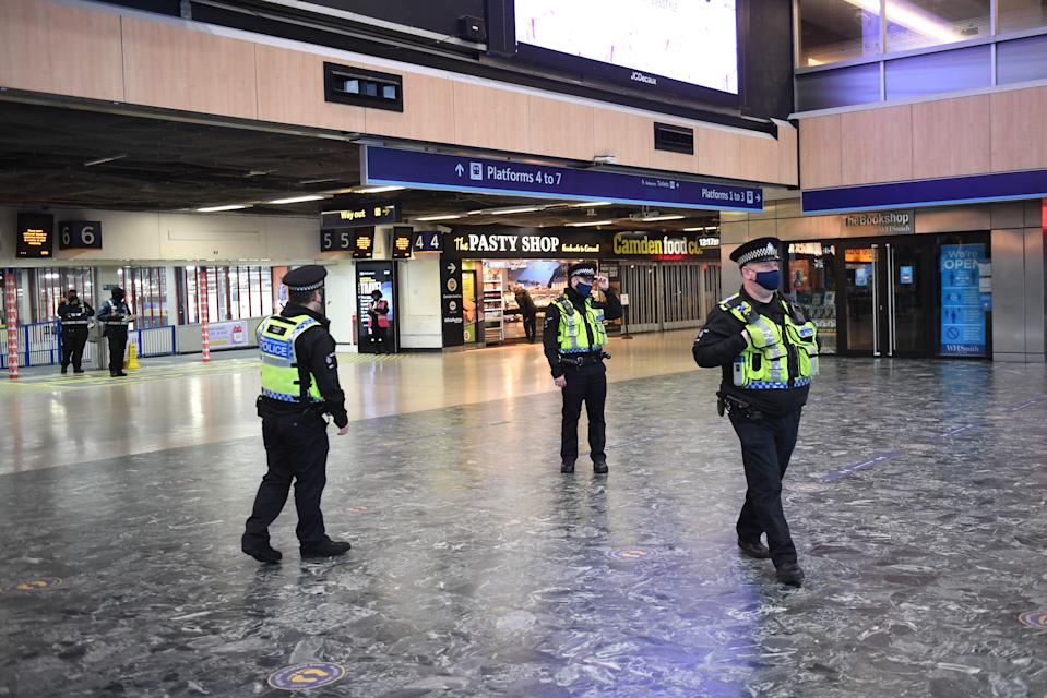 Police officers at Euston Station, London, with more being deployed to enforce travel rules at London's stations, and the public being urged to adhere to Government guidance after Prime Minister Boris Johnson announced on Saturday that from Sunday areas in the South East currently in Tier 3 will be moved into a new Tier 4 for two weeks Ð effectively returning to the lockdown rules of November, after scientists warned of the rapid spread of the new variant coronavirus.