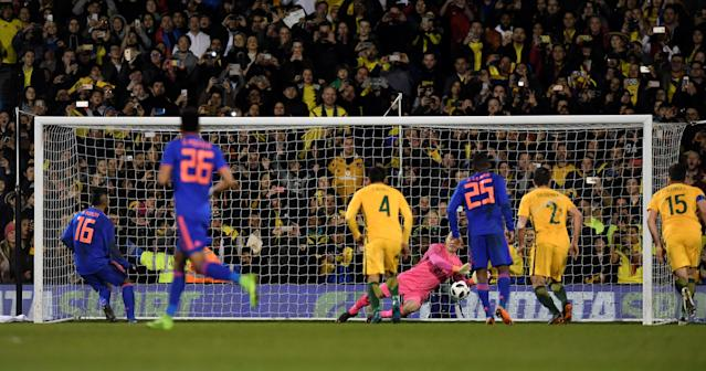 Soccer Football - International Friendly - Australia vs Colombia - Craven Cottage, London, Britain - March 27, 2018 Australia's Danny Vukovic saves a penalty from Colombia's Miguel Borja Action Images via Reuters/Tony O'Brien