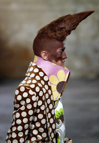 Walter Van Beirendonck's elaborate catwalk beauty look featured conical facial prosthetics, painted complexions and towering hairpieces.