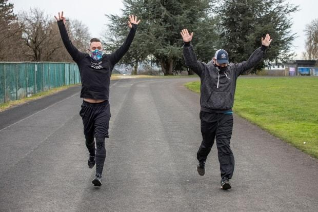 Vancouver actor, Michael Teigen, left, had not been in touch with his old friend, Stephen Gillis, right, for awhile when he learned he needed a kidney transplant. One year ago, the pair were wearing hospital gowns and undergoing surgery and on Thursday, the duo donned sneakers and clocked five kilometres around a Vancouver track.