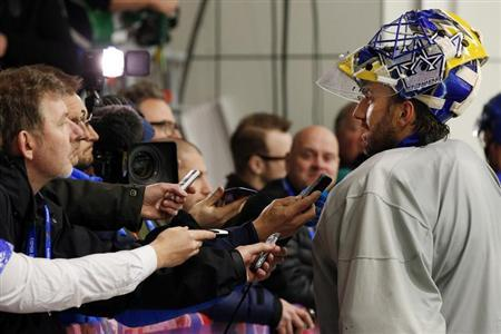 Sweden's goalie Henrik Lundqvist talks to reporters after a men's ice hockey team practice at the 2014 Sochi Winter Olympics February 20, 2014. REUTERS/Brian Snyder