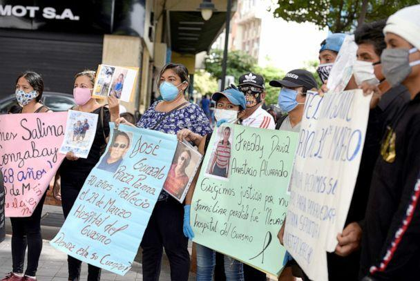PHOTO: Families looking for their deceased loved ones who have been lost or misidentified during the outbreak of the Covid-19 pandemic hold signs during a protest in Guayaquil, Ecuador, May 20, 2020.  (Santiago Arcos/Reuters, FILE)