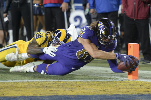 Baltimore Ravens wide receiver Willie Snead, scores past Los Angeles Rams defensive back Marqui Christian during the second half of an NFL football game Monday, Nov. 25, 2019, in Los Angeles. (AP Photo/Kyusung Gong)