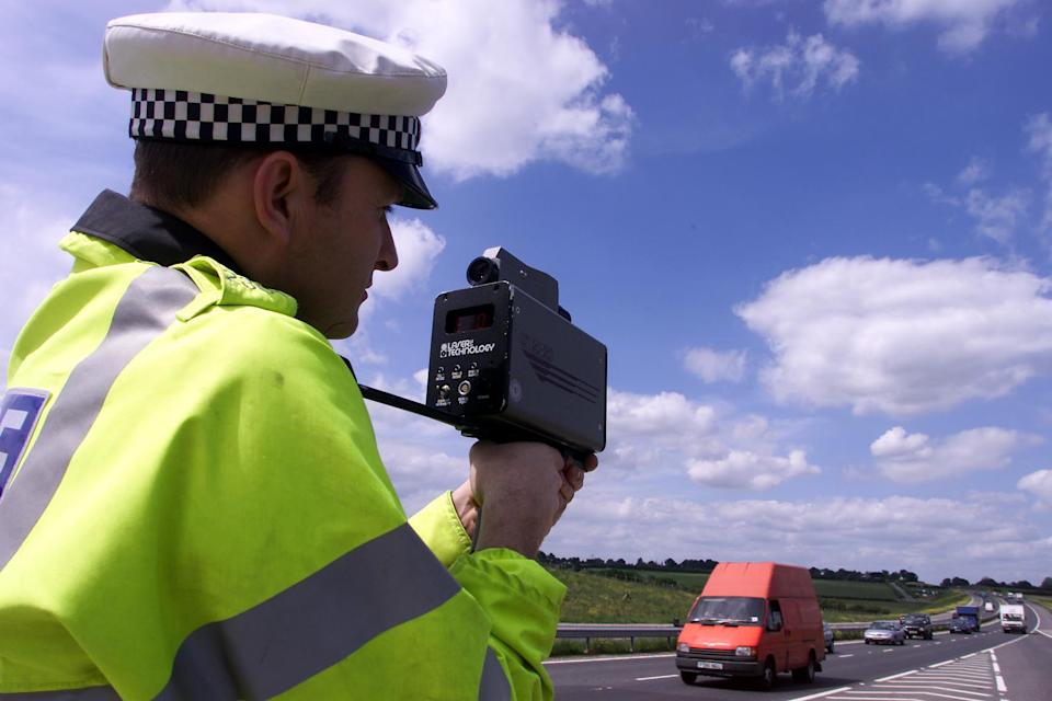 Sgt Paul Moor from Essex Traffic Police uses a laser speed gun on the new stretch of the A130 between Chelmsford and Southend. Forty motorists who drove above 100mph on the new road are appearing at a special court hearing at Witham Magistrates Court.